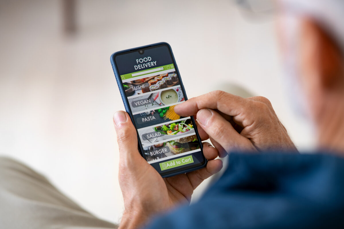 photo of a person using the plant-based businesses guide on their phone